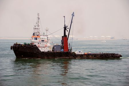Tug boat with crane at Singapore anchorage. photo
