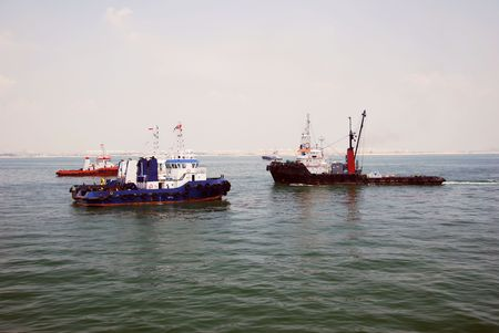 Four tug boats at Singapore anchorage. Stock Photo