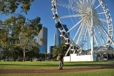 Perth, April, 20, 2010 - People exercising in the nearby of the Ferris-wheel in Perth, Australia