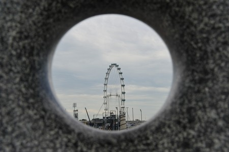 Singapore, August, 29, 2010 - Singapore Flyer through a round hole in a stone.