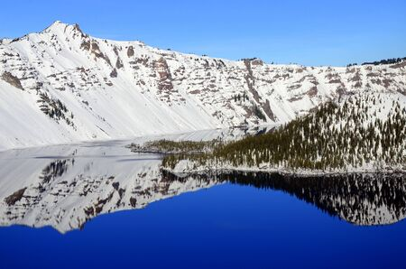 oregon  snow: Winter reflection in Crater Lake, Oregon