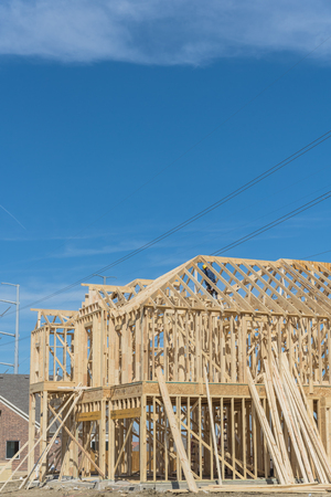 Close-up two-story stick built home under construction in Irving Stock Photo - 95072950