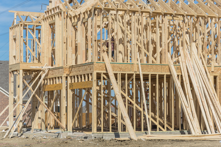 Close-up two-story stick built home under construction in Irving Stock Photo