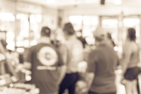 Vintage tone blurred image line of customers at check-out counter grocery in USA. Concept of busy shoppers waiting at local farmer market. Business concept, bokeh light Stok Fotoğraf