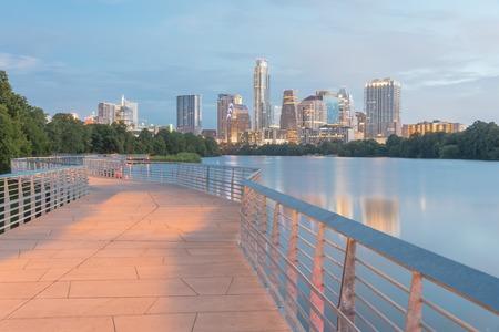 Austin downtown skyscraper reflection along Colorado River at da