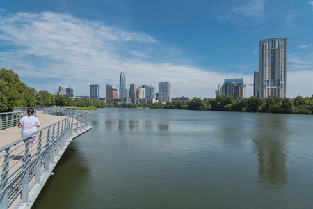 People enjoy outdoor activities on boardwalk in downtown Austin