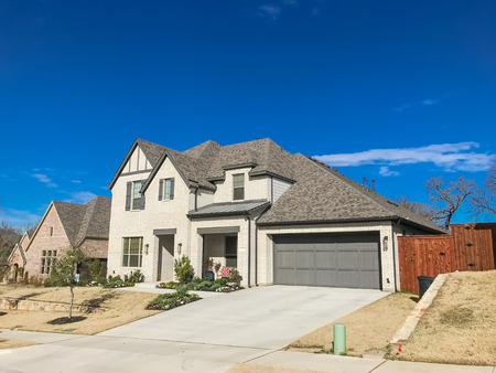 Front porch entrance of newly built 2-story house with attached