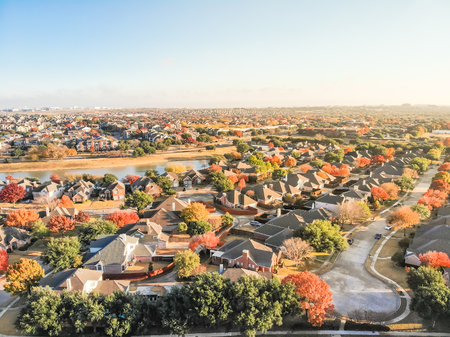 Top view sprawl subdivision with cul-de-sac street and colorful