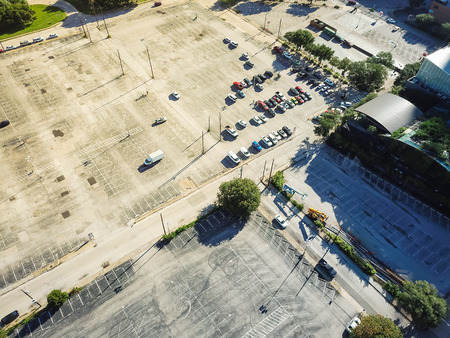 Top view vacant uncovered parking lots in downtown Dallas