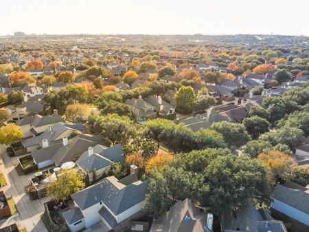 Panoramic top view urban sprawl suburbs Dallas during autumn season 스톡 콘텐츠