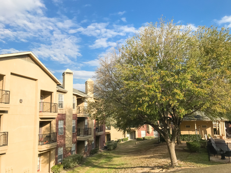 Typical apartment complex with steep grassy backyard in North Texas, America