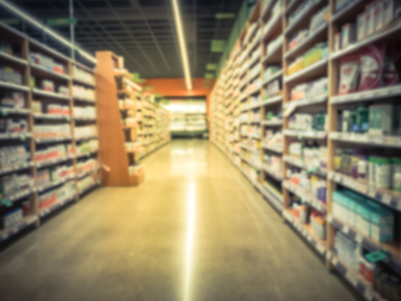 Blurred motion vitamin and supplement department at grocery store in America Imagens