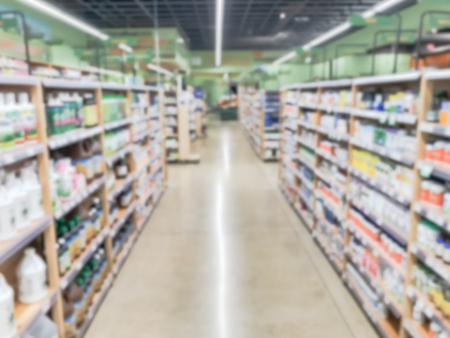 Low angle blurred abstract vitamin and supplement department at grocery store in America