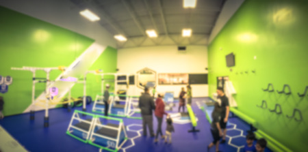 Panoramic blurry background children gym class in USA