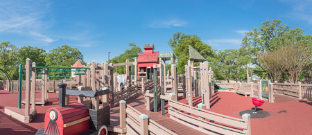 Panorama view castle-inspired structure, elaborate wooden playground with soft rubber surface near Dallas, Texas, USA Stock Photo