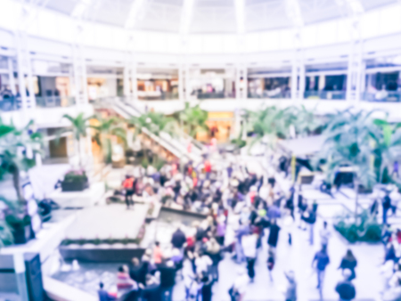 Blurred motion public music show at shopping mall in Texas, America. Crowed audience watching free performance under the glass dorm