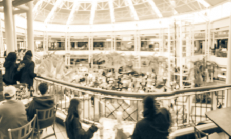 Motion blurred rear view of audience watching free music show from second floor of shopping mall in Texas, America Stock fotó