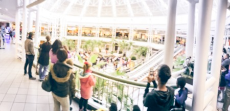 Panorama view blurred abstract public music show at shopping mall in Texas, America. Crowed audience watching free performance under the glass dorm