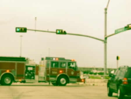 Filtered image blurry background accident at road intersection with fire truck