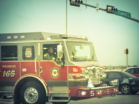 Blurry background accident at road intersection with fire truck Stock Photo
