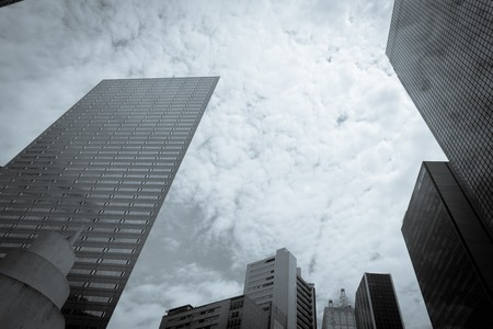 Filtered tone low perspective angle view of Dallas skylines with cloud blue sky