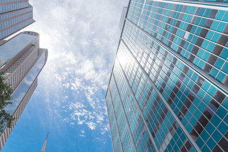 Low perspective angle view of Dallas skylines with cloud blue sky