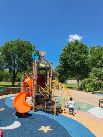 Colorful playground with kids playing in Texas, America