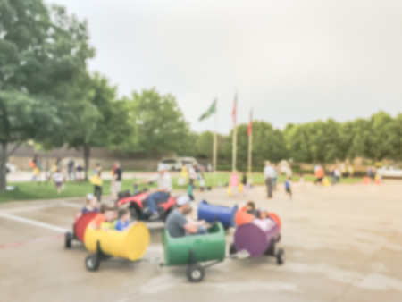 Blurry background fun wagon train ride for kids and parents at school event Stock Photo