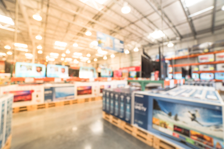 Blurry background row of modern TVs at electronic department of wholesale store Stock fotó
