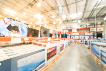 Blurry background row of modern TVs at electronic department of wholesale store Standard-Bild