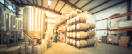 Panoramic view blurry background stack of barrels in cellar at American brewery