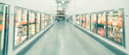 Panoramic view blurry background glass door frozen food aisle at big-box store in USA