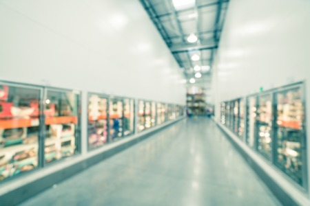 Filtered image blurry background glass door frozen food aisle at big-box store in USA Stock Photo - 123152465