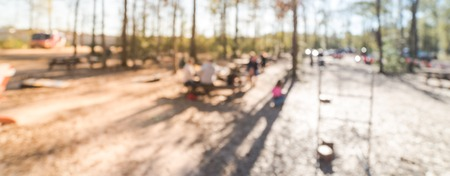 Panoramic view blurry  forest campfire and people hangout at wintertime in Texas, USA
