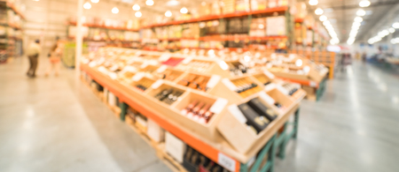 Panoramic view blurry background wide selection of wine at wholesale store in America