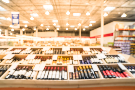 Blurry background wide selection of wine at wholesale store in America