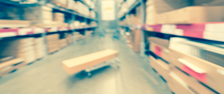 Panoramic view blurry background flatbed cart at giant furniture warehouse store in USA Stock Photo
