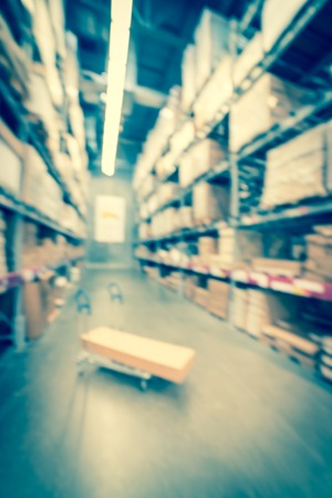 Filtered image blurry background flatbed cart at giant furniture warehouse store in USA Stock Photo