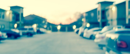 Panoramic view blurry background busy uncovered parking lots at apartment complex in USA Stockfoto