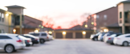 Panoramic view blurry background busy uncovered parking lots at apartment complex in USA Фото со стока