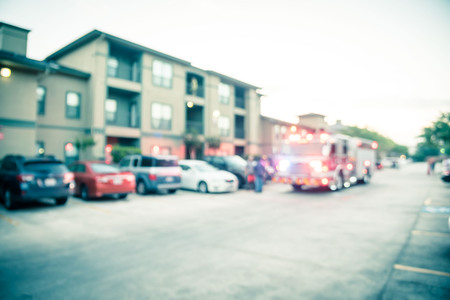 Blurry background fire disaster event at apartment complex in America