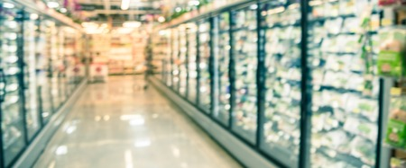 Panoramic view blurry background frozen and processed food selection at American grocery store Stock Photo