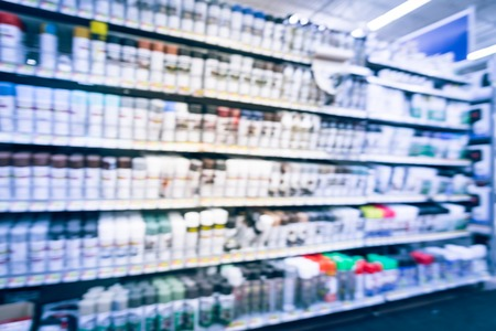 Blurry background variety of paint supplies at American grocery store