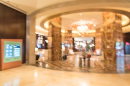 Blurry background lobby with digital signage board at American hotel