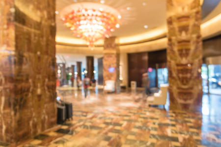 Blurry background lobby with guest luggage at American hotel Stock Photo