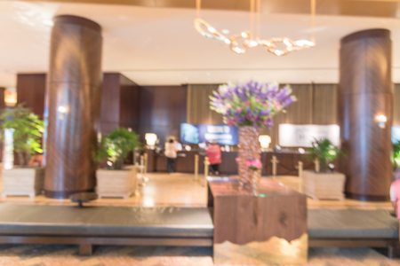 Blurry background huge wooden pillar at lobby of American hotel