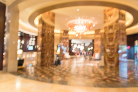 Blurry background lobby of luxury American hotel with round ceiling droplight