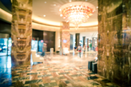 Filtered image blurry background lobby with guest luggage at American hotel Stock Photo