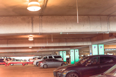 Garage parking at American airport with indicators guidance system. People can look for a parking spot by seeing little overhead green lights. Intelligent sensors IoT, real time ultrasonic direction Фото со стока