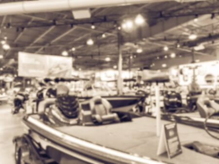 Filtered image blurry background large boat showroom outdoor store in America